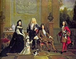 Louis XIV (seated) with his son le Grand Dauphin (to the left), his grandson Louis, Duke of Burgundy (to the right), his great-grandson Louis Duke of Anjou, and Madame de Ventadour, Anjou's governess, who commissioned this painting; busts of Henry IV and Louis XIII are in the background.