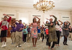Michelle Obama joining students for a 'Bollywood Dance Clinic' in the State Dining Room of the White House, 2013.