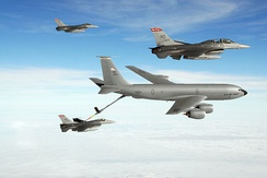KC-135R Stratotanker from 319th Air Refueling Wing refueling F-16 fighters