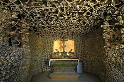 The Skull Chapel in Kudowa-Zdrój, Lower Silesian Voivodeship, Poland is an example of dark tourism. Its interior walls, ceiling and foundations are adorned by human remains. It is the only such monument in Poland, and one of six in Europe.