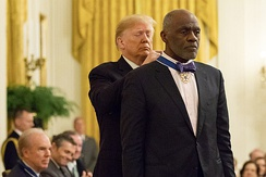 President Donald J. Trump presents the Medal of Freedom to Alan Page Friday, November 16, 2018, in the East Room of the White House.