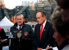 Donald Rumsfeld and Giuliani at the site of the World Trade Center on November 14, 2001