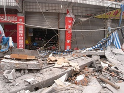 The outside of a warehouse in disarray following the earthquake.