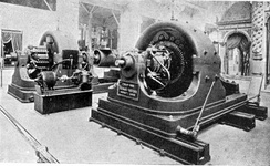 "Westinghouse alternating current polyphase generators on display at the 1893 World's Fair in Chicago, part of their ""Tesla Poly-phase System"". Such polyphase innovations revolutionized transmission"