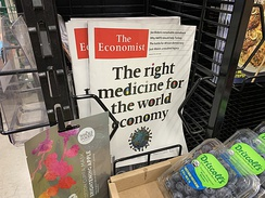 A display of newspapers in Whole Foods supermarket, depicting the COVID-19 pandemic.