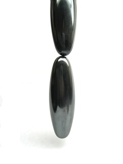 Ovoid-shaped magnets (possibly Hematine), one hanging from another