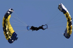 In a down-plane malfunction, there would be one parachutist under two canopies.