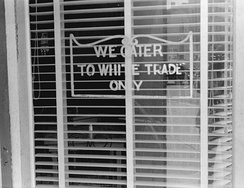 "A sign reading ""We Cater to White Trade Only"