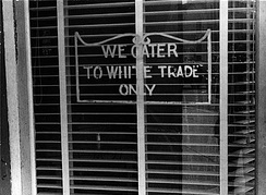 """We Cater to White Trade Only"" sign on a restaurant window in Lancaster, Ohio in 1938. In 1964 Martin Luther King Jr. was arrested and spent a night in jail for attempting to eat at a white-only restaurant in St. Augustine, Florida"