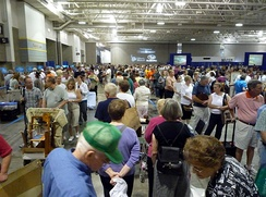 Antiques Roadshow appraises thousands of items in any given taping, with the public ticketed for time slots between 8 am and 5 pm local time; this image shows a portion of the public entering a July 2009 roadshow in Madison, Wisconsin at noon.