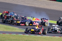 Romain Grosjean (left) was criticised for his role in causing another first-lap incident, this time spinning Mark Webber around at the start of the race.[282][283]