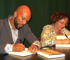Common and his mother, Dr Mahalia Ann Hines, at a September 13, 2011, signing for his memoir at the Barnes & Noble in Tribeca, Manhattan