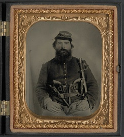 Union cavalryman A.J. Blue armed with three pistols and a sword.