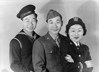 From left to right, a Sailor, a Soldier, and a navy officer take a group photograph.