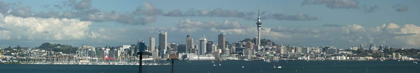 View of Auckland CBD from North Shore. The skyline is dominated by the Sky Tower.