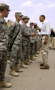 President Barack Obama shaking hands with an American soldier in Basra, Iraq in 2008