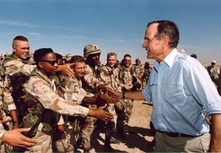 President Bush visiting American troops in Saudi Arabia on Thanksgiving Day, 1990