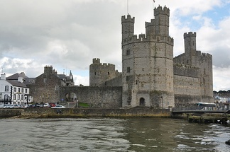Caernarfon Castle from the west. The town's walls, which were mostly complete by 1285, join with the castle and continue off to the left of the photo.