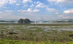 Dumbarton seen across the estuary of the River Clyde at low tide.