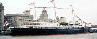 HMY Britannia (with rear admiral aboard) dressed overall on the River Mersey, Liverpool