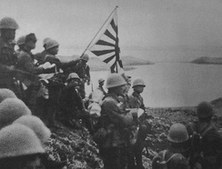Japanese troops raise the Imperial battle flag on Kiska Island in the Aleutians on June 6, 1942.
