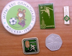 Pins released by the USSR for the football event of the Olympics (with a British 50 pence coin for size comparison)