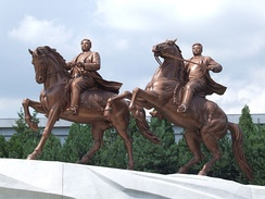Equestrian statues of younger versions of Kim Jong-il (right) and Kim Il-sung, Pyongyang