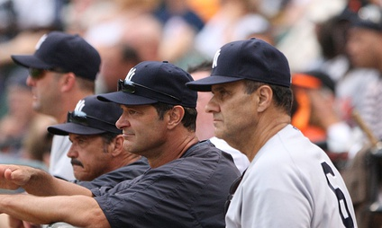 New York Yankees' manager Joe Torre (far right) with coaches (from left to right) Kevin Long, Ron Guidry, and Don Mattingly