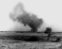 Burning Treblinka II perimeter during the prisoner uprising, 2 August 1943. Barracks were set ablaze, including a tank of petrol which exploded setting fire to the surrounding structures. This clandestine photograph was taken by Franciszek Ząbecki.