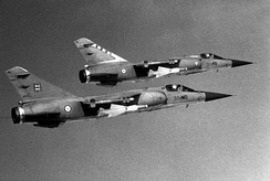 A pair of French Air Force Mirage F1Cs from the EC 2/30 and EC 3/30 in flight, 31 May 1986.