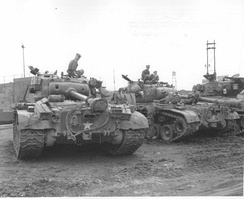 Pershing and Sherman tanks of the 73rd Heavy Tank Battalion at the Pusan Docks, Korea.