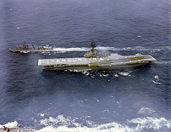 "The crew of USS Kearsarge spells out ""MERCURY 9"" on the flight deck while underway to the recovery area"