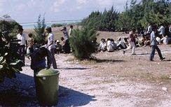 Vietnamese refugees on Wake Island await resettlement processing by U.S. Immigration and Naturalization Service personnel in May 1975