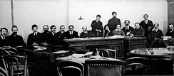 The Sovnarkom during the period of coalition between the Bolsheviks and left socialist revolutionaries. Various members of the Left-SRs appear: Isaac Steinberg (Justice, first from the left), Boris Kamkov (without portfolio, third), V.Y. Trutovski (Local Government, fifth) and Prosh Proshian (Post and Telegraph, seventh).