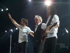 l-r:Paul Rodgers, Roger Taylor, and Brian May live in 2005 for the Queen + Paul Rodgers tour