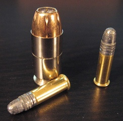 Two .22 LR rounds compared to a .45 ACP cartridge