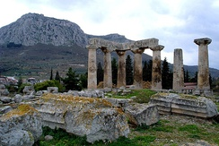 The Temple of Apollo at Corinth, built c. 540 BC, with the Acrocorinth (i.e. the acropolis of Corinth that once held a Macedonian garrison)[156] seen in the background