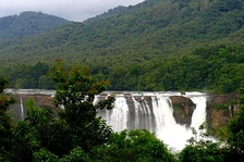 A long view of Athirappilly Falls; the background is the Anamudi Hills.