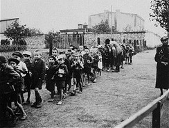 Children rounded up for deportation to the Chełmno death camp, September 1942