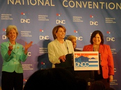 Permanent Chair Nancy Pelosi speaks during a press conference at the Colorado Convention Center the day before the start of the convention, flanked by the three co-chairs.