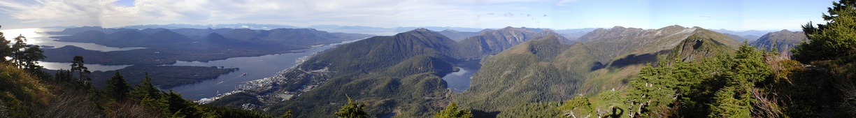 A panorama of downtown Ketchikan and surrounding terrain from the peak of Deer Mountain in October 2004. Pennock Island divides the Tongass Narrows on the left, and Gravina Island lies on the distant side of the Narrows.