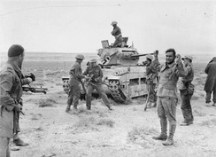 New Zealander soldiers recapture a Matilda tank and take prisoner its German crew during Operation Crusader, 3 December 1941.
