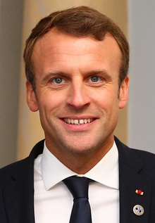 Emmanuel Macron in Tallinn Digital Summit. Welcome dinner hosted by HE Donald Tusk. Handshake (36669381364) (cropped 2).jpg