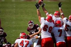 The Fresno State Bulldogs block a Texas A&M field goal attempt.