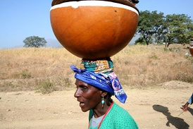 Fulani woman hawking milk and yoghurt