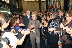 Secretary of State Hillary Clinton is greeted by Department employees during her arrival on her first day.
