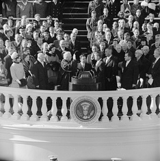 Chief Justice Earl Warren administers the presidential oath of office to John F. Kennedy at the Capitol, January 20, 1961
