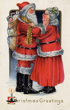 Mrs. Claus says goodbye to her husband as he sets off on his journey in this 1919 postcard