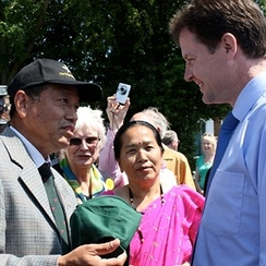 Nick Clegg being presented a Gurkha Hat by a Gurkha veteran during his Maidstone visit, to celebrate the success of their joint campaign for the right to live in the UK, 2009