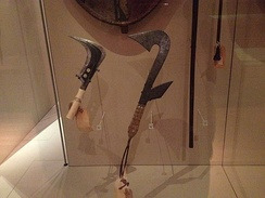 Congolese sickle, or Trumbash, (left) and replica throwing knife (right) at Manchester Museum